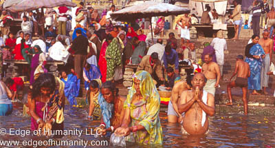 India - Varanasi: People praying and bathing in the Ganges River.