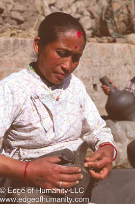 Woman working pottery in the Town Square. Bkaktapur, Nepal.
