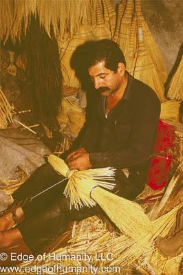 Syrian man making broom.