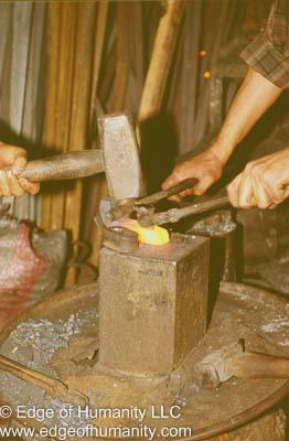 Ironsmith pounding metal.  Aleppo Syria