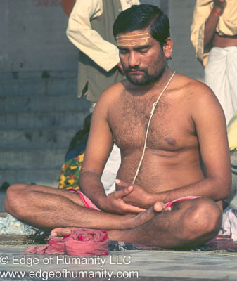 Man meditating on the Ghats of the Ganges River - India.