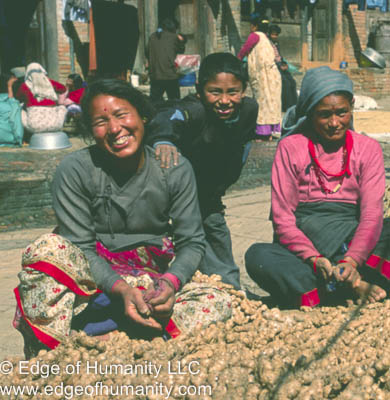 Women cleaning ginger in Nepal.