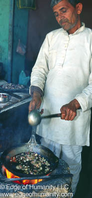 Man  Cooking  at a  Food Stand in India.