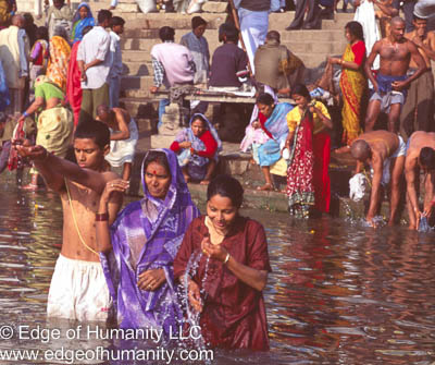 Pilgrims praying and bathing in the Ganges River - India,
