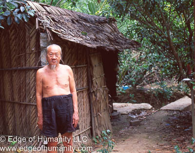 Elderly man and his house at the Mekong River, Vietnam