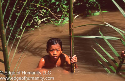 Boy playing in the Mekong River, Vietnam