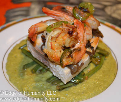 Shrimp with caramelized onions and jalapenos added to swordfish, french beans and cream of asparagus.