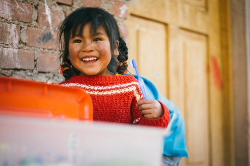 This NGO tries to teach children, often left behind concerning the basics about hygiene. A girl brushing her teeth | Tankarpata, Peru | 20th of June, 2014