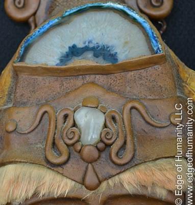 Mask detail adorned animal hair and semi-precious stones. Rio de Janeiro, Brazil.