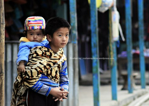 Shot at Dhankuta. This kid was waiting for his parents to come back from shopping - Nepal.