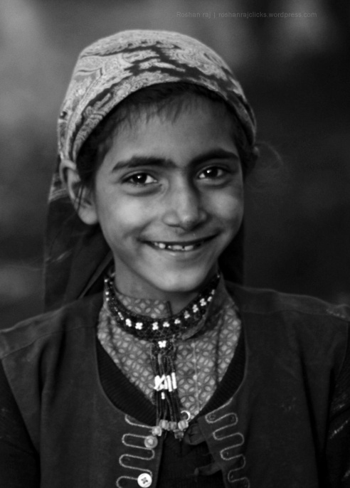 Shot at Punjab. She was playing with her friends at buffalo shed. I shot a group photo and then I did a portrait of her - India.
