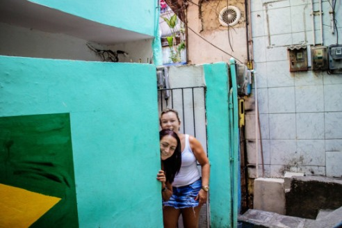 They were surprised and amused to see me with the camera - Vila Canoas Slum (Favela), Rio de Janeiro, Brazil.