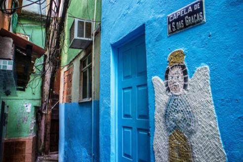 Cables everywhere, but the chapel is in order - Vila Canoas Slum (Favela), Rio de Janeiro, Brazil.