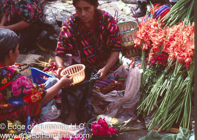 Woman tending to her flower stand in a Guatemala flower market.