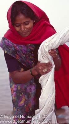 Woman washing laundry at the Laundry Gahts in Varanasi, India.