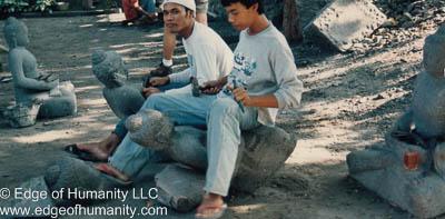 Stone carvers - Indonesia.