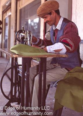 Man sewing in Nepal.