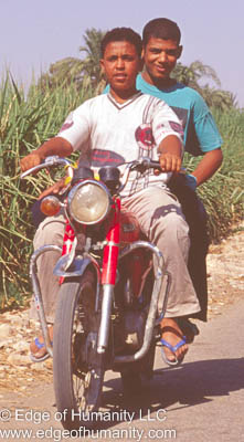 Youngsters moving around on a motor bicycle - Egypt.