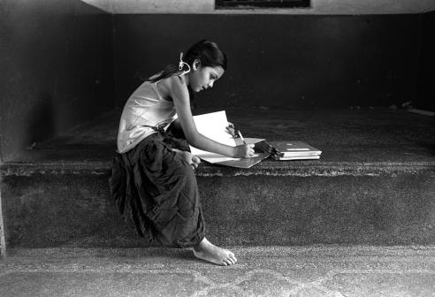 Girl is doing her homework- Pushkar, Rajasthan, India