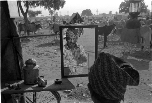 Barber is waiting for the customers in the cattle fair Nagaur, Rajasthan, India