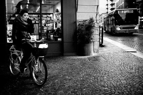 A woman, bike, bus and a cigarette. Como, Italy.