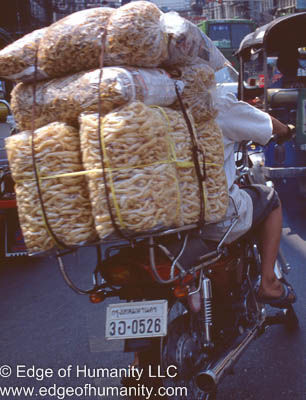 Man transporting goods on motorcycle - Vietnam.