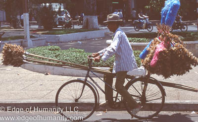 Man transporting goods on bicycle - Vietnam.