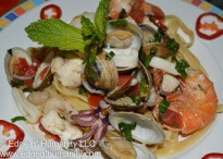Fettuccine with fresh seafood, tomatoes and herbs.