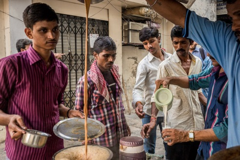 Chai Stall - Mumbai, India: A crowd of customers waiting for their late-morning cup of chai at this busy street corner chai stall.
