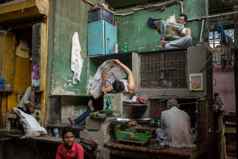 Shopkeepers take a mid-afternoon rest in the chaotic Mirza Ghalib Municipal Market in the Null Bazar area of Mumbai, India.