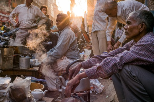 A group of men stop for a masala chai in the late afternoon by the side of the road on chaotic Chawri Bazar in Old Delhi.