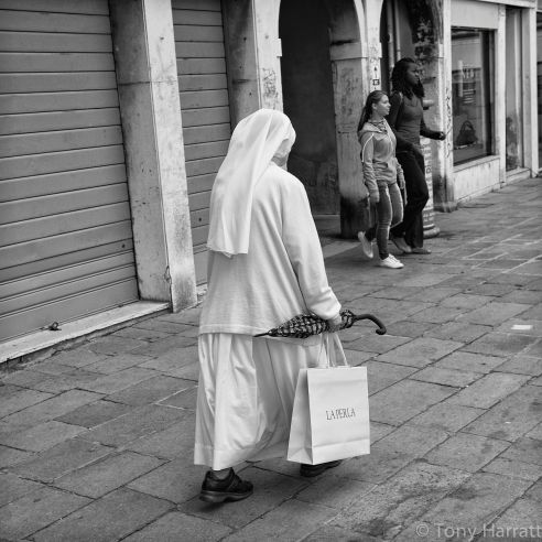 Shopping Venice, Italy This nun had been shopping for what would appear to be a gift. The surprise was the bag; La Perla is a lingerie store in Venice!