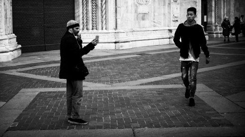Smoking, talking, watching - Como, Italy.