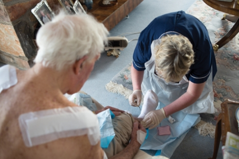 Nurse Jack o'Leary caring for her patient - Usk, South Wales.