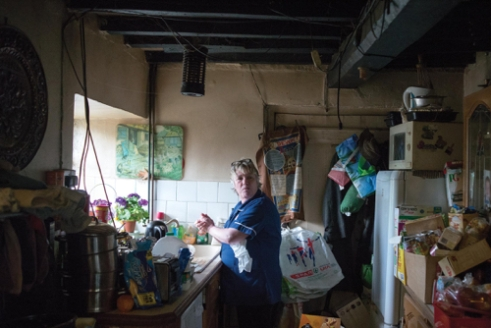 Nurse Jack o'Leary in her patient's kitchen - Usk, South Wales