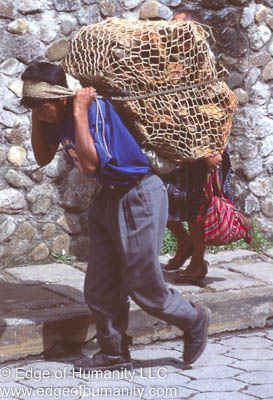 Man transporting goods on his back, Guatemala.