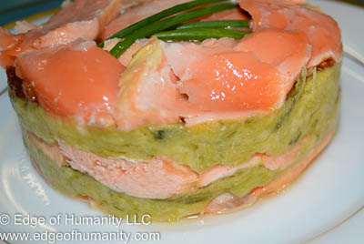 Salmon and leek pureé after the round ring mold is removed.