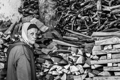 Man tending to his wood storage in the industrial part of Essaouira, Morocco.
