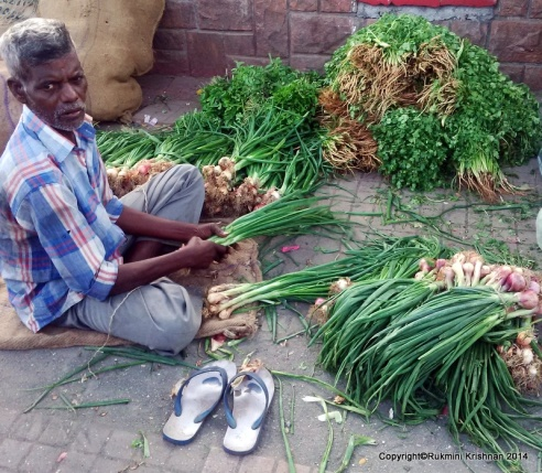 Man sorting veggies - Jambli Naka, Thane, Mumbai, India.