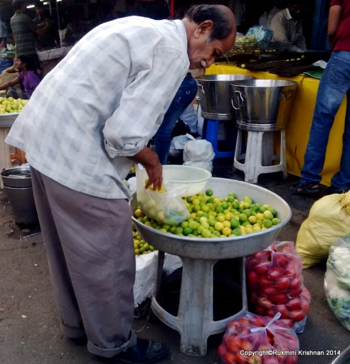 Person sorting the lemons  - Jambli Naka, Thane, Mumbai, India.