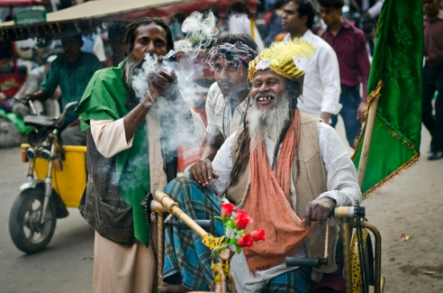 "Sufi saints enjoy smoking chilum(clay pipe filled with ganja) at the first meeting in front of Jama Masjid in Delhi before starting journey to Ajmer. ________________________________ There is a tomb in Ajmer,India that is ruling the country, respected by all regardless of caste or religion , it's the resting place of Kwaja Gharib Nawaz (the Benefactor of the poor) This story is about love to a holy man who is spiritual founder of Islam in India . He was one of the first Sufi saint in India. From the time of prophet Mohamed some of the hidden knowledge was transmitted ''from heart to heart"" that is how Sufi lineages begin..For every outside there is inside .Sufism is a soul of Islam. Every year a colorful crowd of fakirs and devotees coming all the way from Delhi to Ajmer (500km)by foot ,on wheelchairs ,bicycles ,bikes to pay respect to their beloved Baba. They go for Urs(festival) which is not only memorial service in the name of Kwaja Baba but also a sacred wedding of the soul to God."