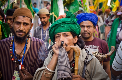 Fakir with his companions and his chilum. Marijuana is important part of the Sufi culture in India regarded as a holy plant also gives relief from the pain during a long journey. Annual pilgrimage to the tomb of the Muslim Sufi saint Kwaja Gharib Nawaz in Ajmer,India