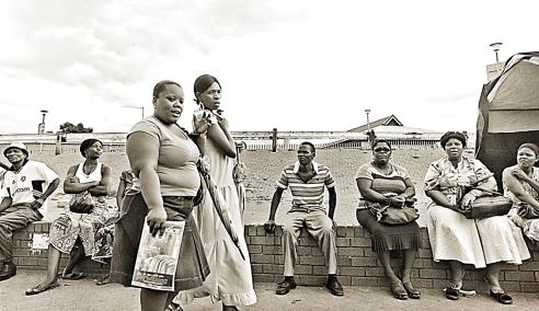 "The downtown terminal"" This is a scene at the taxi rank in Rustenburg, South Africa. I enjoyed the diverse range of emotions expressed from the bystanders of this image when they glimpsed me shooting!"