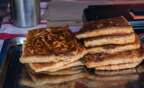 Murtabak akin to a pancake with a minced meat egg and onion filling. Ramadan bazaar at Semenyih Sentral, Selangor, Malaysia