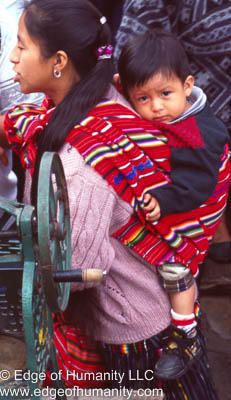 Mother carrying child Guatemala