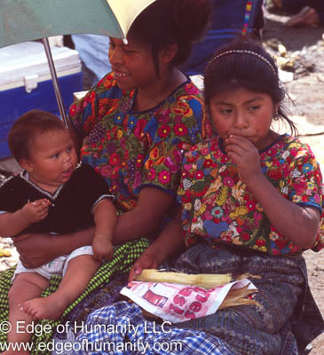 Family at the food market Guatemala