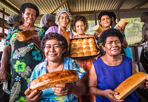 Bakers: With deforestation out of the question, villages along the lower shore of Natewa Bay partake in various crafts, traditions and businesses in order to support themselves economically. The Vusasivu Bakers proudly supply villagers with fresh bread cooked over open fires.