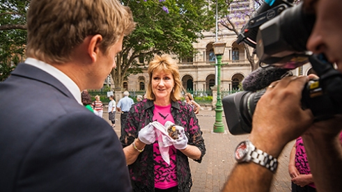 Lousie Saunders: Louise Saunders, president of Queensland Bat Conservation & Rescue, speaks to the media about the legalised slaughter of Flying-foxes by the Queensland Government. In her hand, she holds an orphaned juvenile black flying-fox rescued that morning.