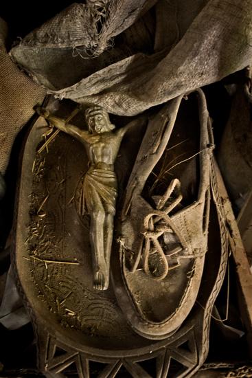 Brocken figure of Jesus, lying in the barn.