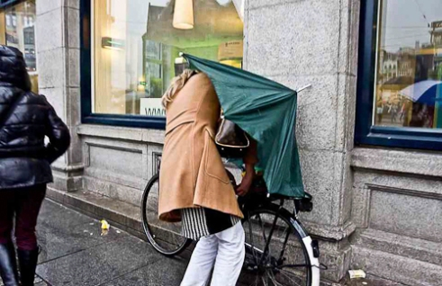 """Trying to reach home dry"" Amsterdam, Netherlands"